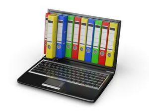 dessin d'un ordinateur avec des dossiers sur l'écran