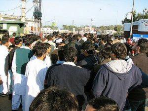 Photographie de migrants à la frontière pakistanaise