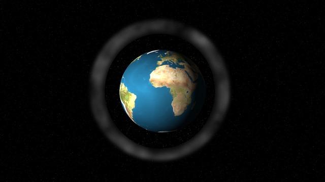 image de la terre entourée d'un halo sur fond noir