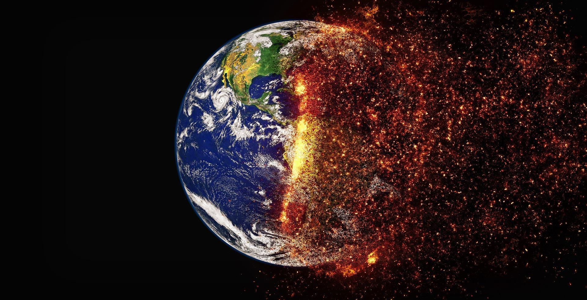 La terre vue de l'espace, une moitié en combustion.