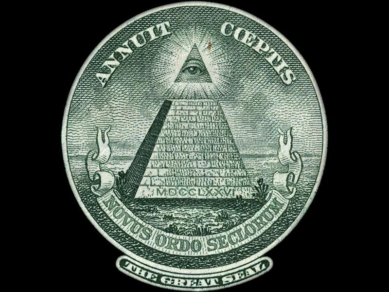 Symbole de l'œil surmontant la pyramide sur le billet d'un dollar américain
